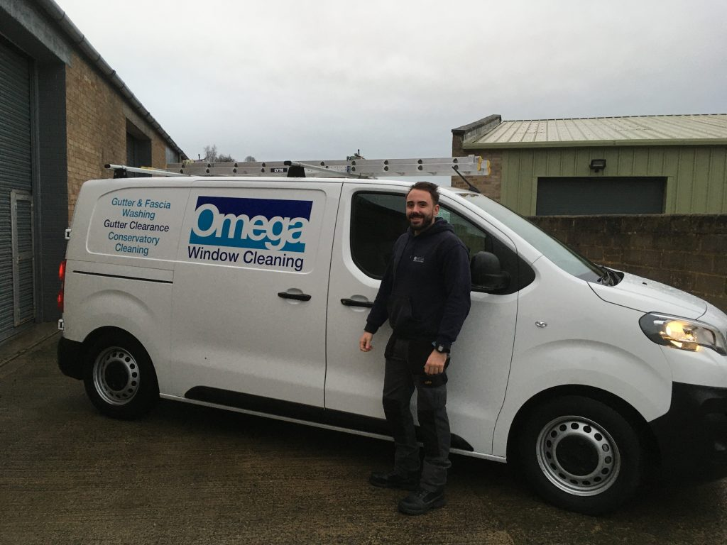 Omega Window Cleaning - WFP van and window cleaner Adam.